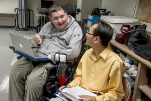 Man with disability using assistive technology