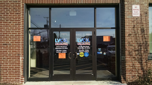 "Front doors of Lehigh Valley Center for Independent Living offices. ""LVCIL"" is written in big letters across the glass doors."