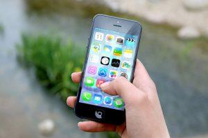 Hand holding smart phone.