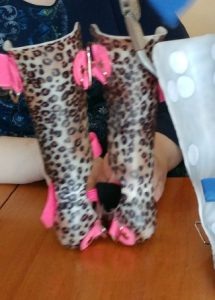 Close up of Helens leopard print and pink Ankle Foot Orthoses.