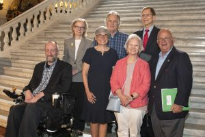 Seven PATF board members pose together for a photo on the steps at the Capitol Rotunda.