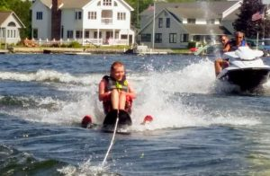A man rides adaptive water skis
